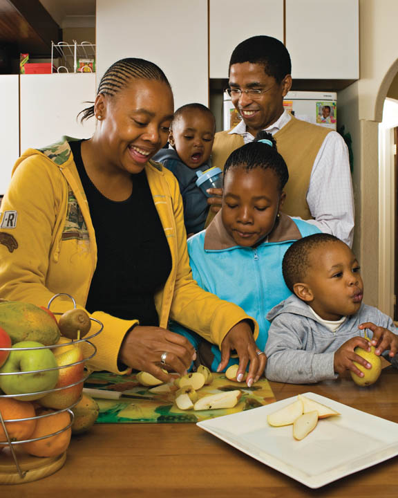 A photo of an African-American family preparing dinner together.