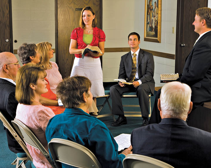A photo of a young woman speaking in a Sunday School class.