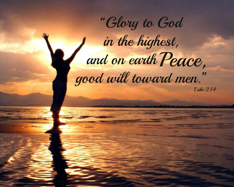 """Glory to God in the highest, and on earth peace, good will toward men."" - Luke 2:14; A silhouette photo of a woman standing on the beach at sunset with her arms lifted in the air."